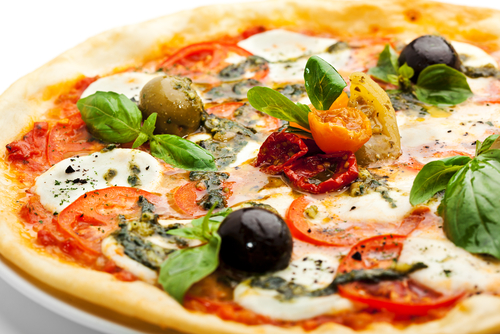 Gourmet pizza toppings can brighten the Italian classic for restaurant menus