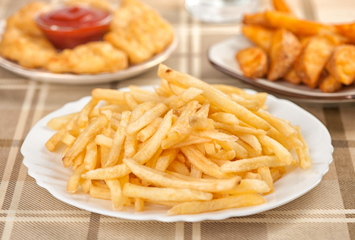 Preparing more completely home-cooked foods can instantly lower the amount of trans fats on menus.